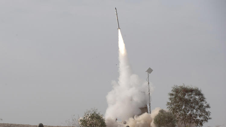 FILE - In this Nov. 17, 2012 an Israeli Iron Dome missile is launched near the city of Be'er Sheva, southern Israel, to intercept a rocket fired from Gaza. INov. 17, 2012. An Israeli air attack reportedly staged in Syria this week may be a sign of things to come. Israeli military officials appear to have concluded that the risks in attacking Syria are worth taking when compared to the dangers of allowing sophisticated weapons to reach Hezbollah guerrillas in neighboring Lebanon. (AP Photo/Ahikam Seri, File)