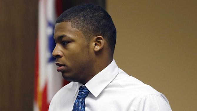 Ma'lik Richmond, 16, enters court before the start of the third day of his trial with co-defendant Trent Mays, 17, (not seen) on rape charges in juvenile court on Friday, March 15, 2013 in Steubenville, Ohio. Mays and Richmond are accused of raping a 16-year-old West Virginia girl in August of 2012. (AP Photo/Keith Srakocic, Pool)