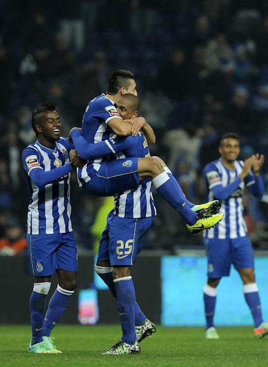 FC Porto's Hector Herrera, centre on top, from Mexico is grabbed by Fernando Reges, from Brazil, with Kelvin Oliveira, left, and Danilo Silva, both from Brazil, as they celebrate their team fourth