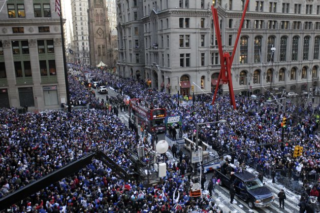 The New York Giants  make their way up Broadway during the team's NFL football Super Bowl parade in New York, Tuesday, Feb. 7, 2012. The Giants returned from their Super Bowl win to a celebration the