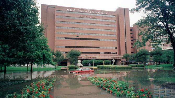 This June 9, 2001 photo from the Houston Chronicle made available by the Texas Medical Center shows flooding from tropical storm Allison in front of the MD Anderson Cancer Center in Houston. The floods caused a massive blackout, inundated medical center streets with up to 9 feet of water, and forced evacuations of patients from the district's 6,900 hospital beds. If metropolitan New York is going to defend itself from surges like the one that overwhelmed the region during Superstorm Sandy, decision makers can start by studying how others have fought the threat of fast-rising water. (AP Photo/Houston Chronicle)