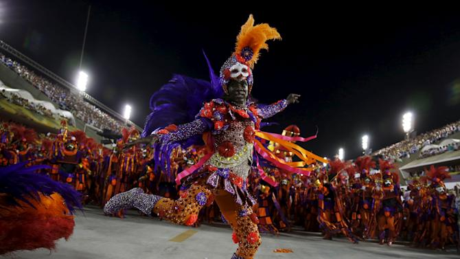 A reveller of the Vila Isabel samba school performs during the carnival parade at the Sambadrome in Rio de Janeiro