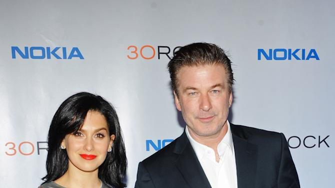"IMAGE DISTRIBUTED FOR NOKIA - Hilaria Thomas, left, Alec Baldwin attend the Nokia ""30 Rock"" wrap party on Thursday, Dec. 20, 2012 in New York. (Photo by Scott Gries/Invision for Nokia/AP Images)"