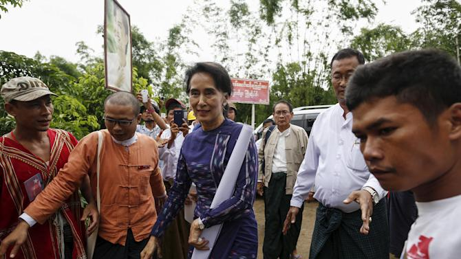 Suu Kyi arrives for her door-to-door visits for voter education campaign at Warheinkha village