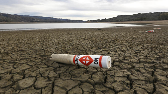 FILE -- In this Feb. 4, 2014 file photo a warning buoy sits on the dry, cracked bed of Lake Mendocino near Ukiah, Calif. Gov. Jerry Brown was governor the last time California had a drought of epic proportions, in 1975-76 and now is pushing a controversial $25 billion plan to build twin tunnels to ship water from the Sacramento-San Joaquin River Delta to farmland and cities further south. (AP Photo/Rich Pedroncelli, file)