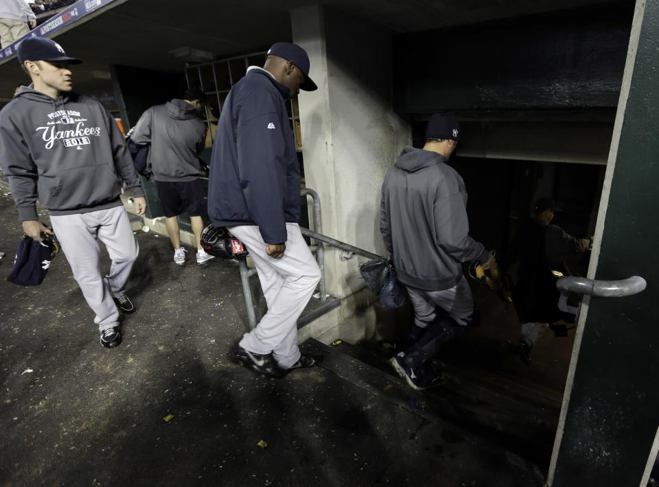 Members of the New York Yankees leave the dugout after Game 4 of the American League championship series against the Detroit Tigers, Thursday, Oct. 18, 2012, in Detroit. The Tigers won 8-1 and move on to the World Series. (AP Photo/Paul Sancya)