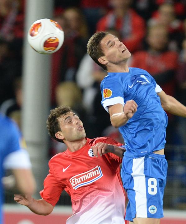 Admir Mehmedi , left,  of Freiburg and David Pavelka  of Liberec vie for the ball during the UEFA Europa League Group H soccer match between SC Freiburg and Slovan Liberec FC  in Freiburg, Germany, Th