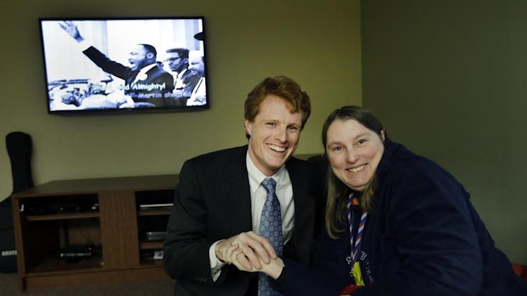 U.S. Rep. Joseph Kennedy III, D-Mass., greets Dawn O'Sullivan of Hopedale, Mass., Monday, Feb. 11, 2013 in the lounge of the Seven Hills Foundation's new facility in Milford, Mass. Seven Hills features the ASPIRE! program for people with developmental disabilities. (AP Photo/Elise Amendola)