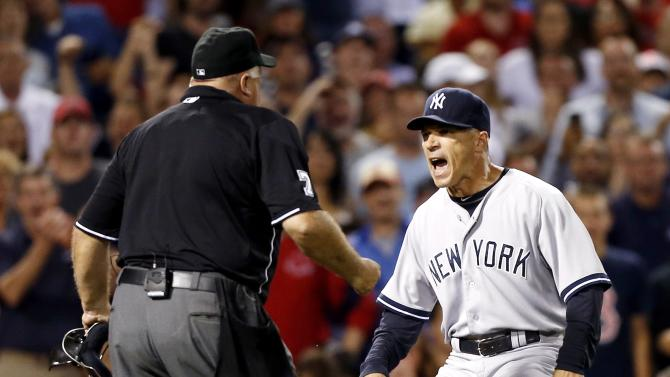 New York Yankees manger Joe Girardi, right, argues with home plate umpire Brian O'Nora after Alex Rodriguez was hit by a pitch in the second inning of a baseball game in Boston, Sunday, Aug. 18, 2013. (AP Photo/Michael Dwyer)