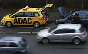A breakdown service car of German car club ADAC parks in front of a stalled car in Ruesselsheim