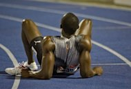 Jamaican sprinter Usain Bolt lies on the ground after finishing second in the men&#39;s 200m final of the Jamaican Olympic Athletic Trials at the National Stadium in Kingston, July 01, 2012