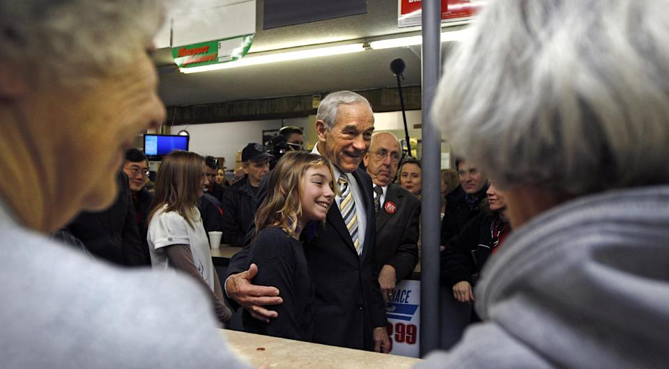 Republican presidential candidate Rep. Ron Paul, R-Texas, poses for a photograph while campaigning at Sandy's Variety Store in Manchester, N.H., Tuesday Dec. 20, 2011. (AP Photo/Charles Krupa)