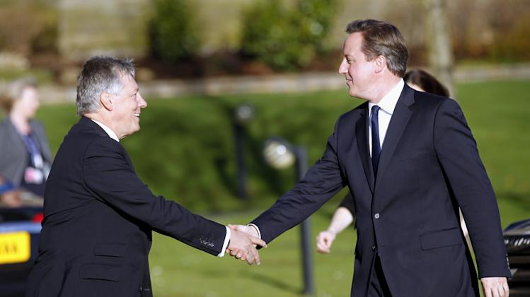 British Prime Minister David Cameron, right, meets  Northern Ireland First Minister Peter Robinson at Stormont Castle, Belfast, Northern Ireland, Tuesday, Nov. 20, 2012. The Prime Minister arrived in the province to announce that that the G8 summit will be held in  Fermanagh  Northern Ireland in June 2013.  (AP Photo/Peter Morrison)