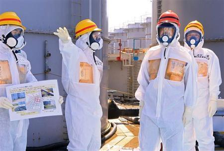 Japan's PM is briefed about tanks containing radioactive water by Fukushima Daiichi nuclear power plant chief Ono during his inspection tour to the TEPCO's tsunami-crippled Fukushima Daiichi nuclear power plant in Okuma
