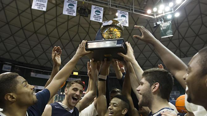 Members of the George Washington basketball team hold up the championship trophy after an NCAA college basketball game against Wichita State at the Diamond Head Classic on Thursday, Dec. 25, 2014, in Honolulu. George Washington won 60-54. (AP Photo/Eugene Tanner)