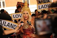 A fan of US pop diva Lady Gaga arrives at Bangkok's Don Mueang airport in May 2012. First she made a joke about buying a fake rolex. Now Thailand's culture ministry has filed a complaint to police against Lady Gaga for misuse of the Thai flag during her show last month