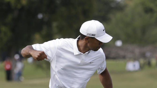 Tiger Woods celebrates after making birdie on the fourth green during the third round of the Cadillac Championship golf tournament Saturday, March 9, 2013, in Doral, Fla. (AP Photo/Wilfredo Lee)
