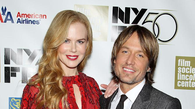 """This image released by Starpix shows actress and honoree Nicole Kidman, left, and her husband Keith Urban at a gala by The Film Society of Lincoln Center following by the premiere of  her film, """"The Paperboy"""" at the 2012 New York Film Festival at Alice Tully Hall, Wednesday, Oct. 3, 2012 in New York. Urban, a judge on the singing competition series """"American Idol,"""" has become more than just a judge: he's also the pacifier on the newly-minted panel.  A blurry web video released Tuesday by TMZ.com shows an argument between fellow judges Nicki Minaj and Mariah Carey and Urban seated between them.  """"We're all passionate people and we're learning a new dance and we're all a work in progress,"""" Urban said Wednesday at the New York Film Festival gala honoring his wife. When asked what it feels like to be stationed between the dueling divas , Urban said, """"Best seat in the house.""""   (AP Photo/Starpix, Marion Curtis)"""