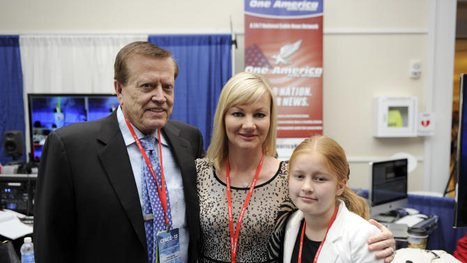 IMAGE DISTRIBUTED FOR BFI-GOOD NEWS SOURCE ONE AMERICA - Founder of One America, Robert Herring and his wife Tanya, center, and daughter Angela at the Conservative Political Action Conference on Thursday March 14, 2013, in Oxon Hill, Maryland. (Photo by Nick Wass/Invision for BFI-Good News Source One America/AP Images)