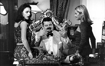 Zukovsky ( Robbie Coltrane ) sits in his casino lair in MGM's The World Is Not Enough