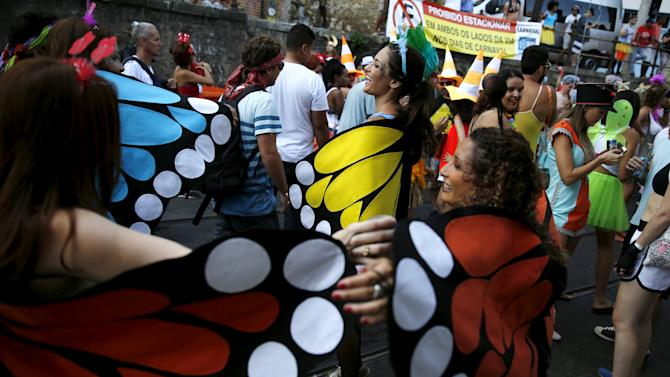 "Revellers take part in an annual block party known as ""Ceu na Terra"" in Rio de Janeiro"