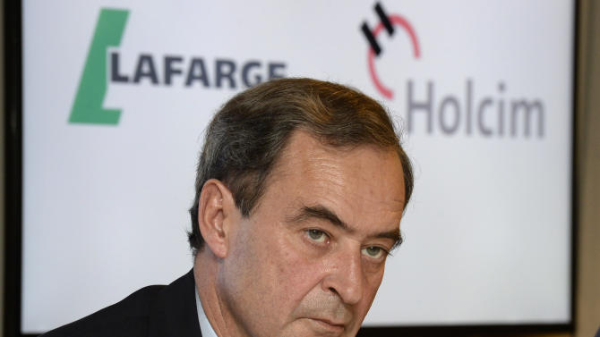 """Bruno Lafont, future chairman of LafargeHolcim speaks at a news conference in Zurich, Switzerland, Monday, April 7, 2014. Swiss-based Holcim and its French counterpart, Lafarge, two of the world's largest suppliers of building materials announced plans for a """"merger of equals"""" Monday that would create an industry giant with a combined 32 billion euros (US dollar 44 billion) in annual revenues. (AP Photo/Keystone, Steffen Schmidt)"""