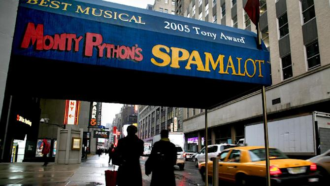 "FILE - In this Tuesday, Nov. 25, 2008 file photo, pedestrians walk under the marquee of the Broadway show ""Monty Python's Spamalot"" at the Shubert Theatre in New York. A producer of the film ""Monty Python and the Holy Grail"" is suing the comedy troupe over royalties from the hit stage musical ""Spamalot."" Producer Mark Forstater wants a bigger share of proceeds from the show, which is based on the 1975 movie spoof of the legend of King Arthur. Python members Eric Idle, Michael Palin and Terry Jones are to give evidence during a five-day hearing that began Friday, Nov. 30, 2012 at London's High Court. (AP Photo/Craig Ruttle, File )"