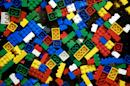 FILE - An undated photo from files showing pieces of Lego. Lego says its popular multi-colored toy blocks were in strong demand in the first half of the year, resulting in good growth in profits and revenue and an upbeat outlook for the full year. Net profit in the first six months of 2015 was up 30 percent at 3.6 billion kroner ($543 million) while sales grew to 14.1 billion kroner from 11.6 billion kroner a year earlier. (Thomas Borberg/Polfoto via AP, File) DENMARK OUT