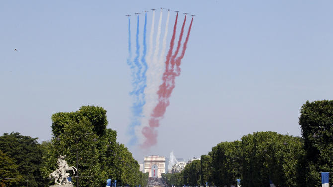 Jets form the Patrouille de France fly over the Champs Avenue at the start of the Bastille Day parade Sunday, July 14, 2013 in Paris. (AP Photo/Francois Mori)