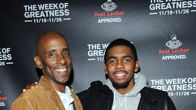 IMAGE DISTRIBUTED FOR FOOT LOCKER - Cleveland Cavalier's point guard Kyrie Irving, right, and his father Drederick Irving kick off the Foot Locker Week of Greatness Preview Event on Monday, Nov. 12 in New York. (Photo by Scott Gries/Invision for Foot Locker/AP Images)