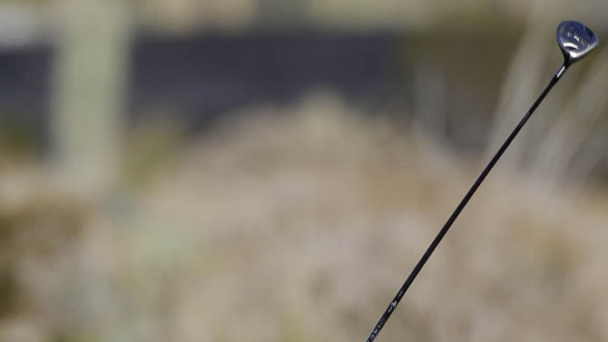 Graeme McDowell hits a shot off the first fairway during extra holes against Alexander Noren in the second round of play during the Match Play Championship golf tournament, Friday, Feb. 22, 2013, in Marana, Ariz. McDowell won 1 up in 20 holes. (AP Photo/Ted S. Warren)