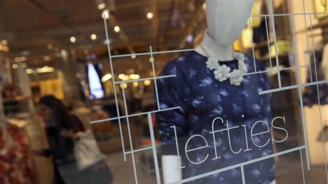 A woman shops at a Lefties store in Madrid