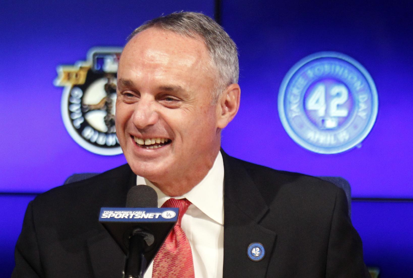 Manfred downplays possibility of big leaguers in Olympics