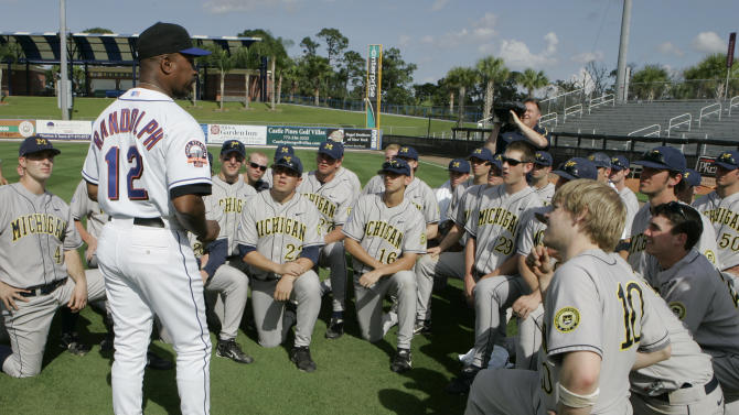 FILE - This file photo from Feb. 26, 2008, shows New York Mets manager Willie Randolph addressing Michigan's NCAA college baseball players following a baseball spring training game, in Port St. Lucie, Fla. Major League Baseball might provide scholarships and exert greater influence over Division I college baseball if a proposed partnership with the NCAA becomes reality. A spokesman for MLB, the head of the players union and the NCAA confirmed preliminary discussions have been held, most recently last month in New York. (AP Photo/Nati Harnik, FIle)