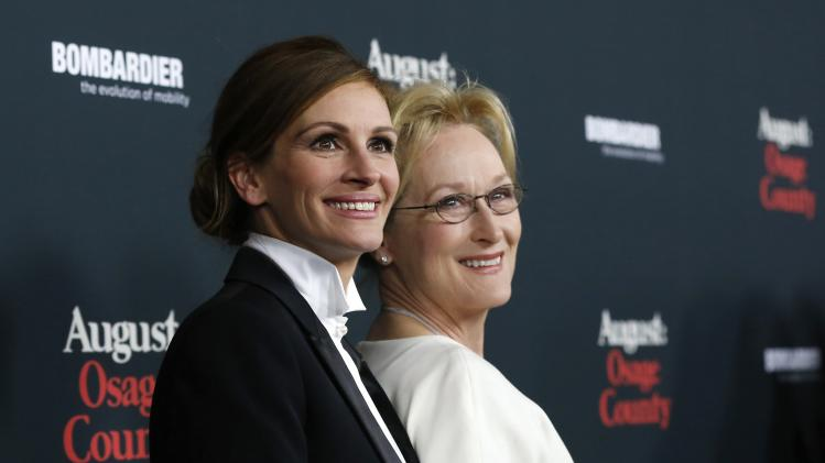"File photo of Roberts and Streep posing at the premiere of ""August: Osage County"" in Los Angeles"