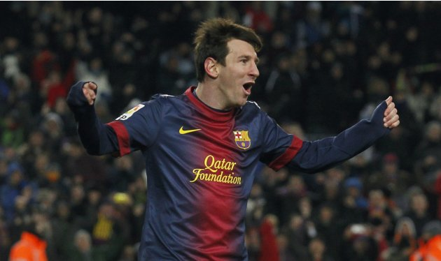 Barcelona's Lionel Messi celebrates a goal against Sevilla during their Spanish First division soccer league match at Camp Nou stadium in Barcelona