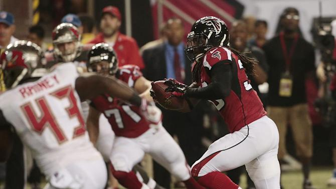 Atlanta Falcons defensive back Kemal Ishmael (36) runs back a ball he intercepted against the Tampa Bay Buccaneers during the first half of an NFL football game, Thursday, Sept. 18, 2014, in Atlanta. Ishmael  scored a touchdown on the play