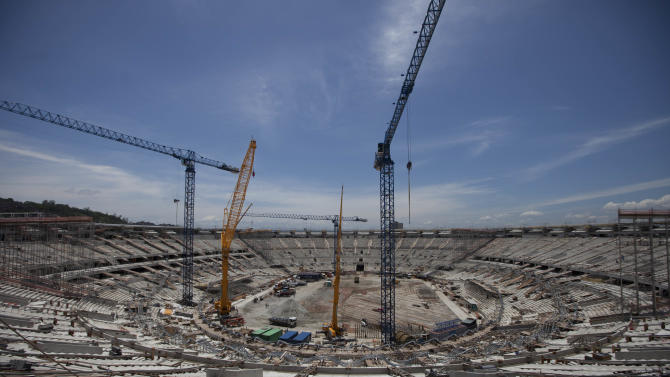 Construction continues at the Maracana soccer stadium during a tour for journalists organized by the Rio 2016 Committee in Rio de Janeiro, Brazil, Monday, Nov. 19, 2012. The IOC Official Debriefing of the London 2012 Games will take place from Nov. 17 to 21 in Rio de Janeiro.  (AP Photo/Felipe Dana)