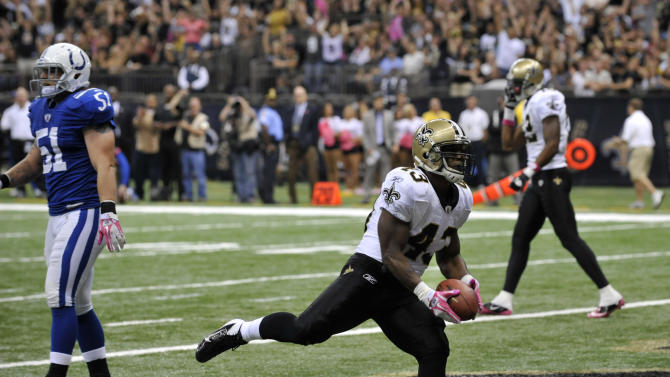 New Orleans Saints running back Darren Sproles (43) dances into the end zone on a touchdown as Indianapolis Colts middle linebacker Pat Angerer (51) walks away during the first half of an NFL football game at the Superdome in New Orleans, Sunday, Oct. 23, 2011. (AP Photo/Bill Feig)