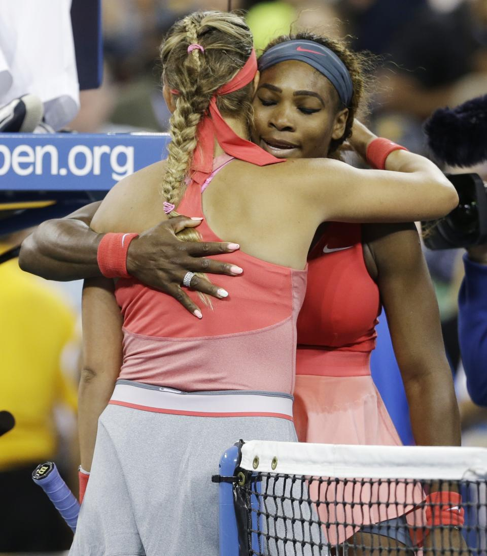 Serena Williams, right, hugs Victoria Azarenka, of Belarus, after winning the women's singles final of the 2013 U.S. Open tennis tournament, Sunday, Sept. 8, 2013, in New York. (AP Photo/Darron Cummings)