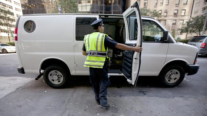 A New York City police officer examines a commercial vehicle at a checkpoint on 59th St. and Park Ave. on Friday, Sept. 9, 2011 in New York. The city is deploying additional resources and taking other security steps in response to a potential terror threat before the 10th anniversary of the Sept. 11 attacks. U.S. counterterrorism officials are chasing a credible but unconfirmed al-Qaida threat to use a car bomb on bridges or tunnels in New York or Washington. (AP Photo/Jin Lee)
