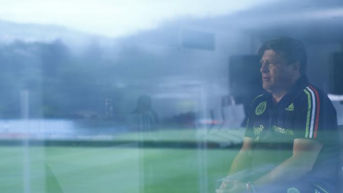 Mexico's coach Miguel Herrera is reflected in a window as he speaks during an interview with Reuters in Mexico City