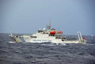 This file photo, taken by Japan Coast Guard, shows a Chinese maritime surveillance ship cruising near a group of disputed islands known as the Senkaku in Japan and the Diaoyu in China, in the East China Sea, on November 27, 2012. Three Chinese state-owned ships entered the waters again on Friday, in the first intrusion since a new government was elected in Tokyo