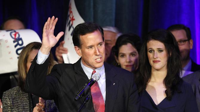 Republican presidential candidate, former Pennsylvania Sen. Rick Santorum wavwes to supporters s at his primary night rally in Grand Rapids, Mich., Tuesday, Feb. 28, 2012. (AP Photo/Paul Sancya)