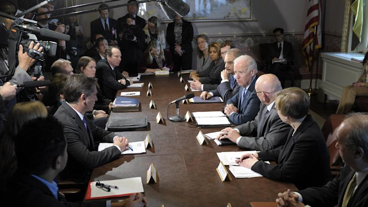 Vice President Joe Biden, fourth from right, with Attorney General Eric Holder at his left, speaks during a meeting with victim's groups and gun safety organizations in the Eisenhower Executive Office Building on the White House complex in Washington, Wednesday, Jan. 9, 2013. Biden is holding a series of meetings this week as part of the effort he is leading to develop policy proposals in response to the Newtown, Conn., school shooting (AP Photo/Susan Walsh)
