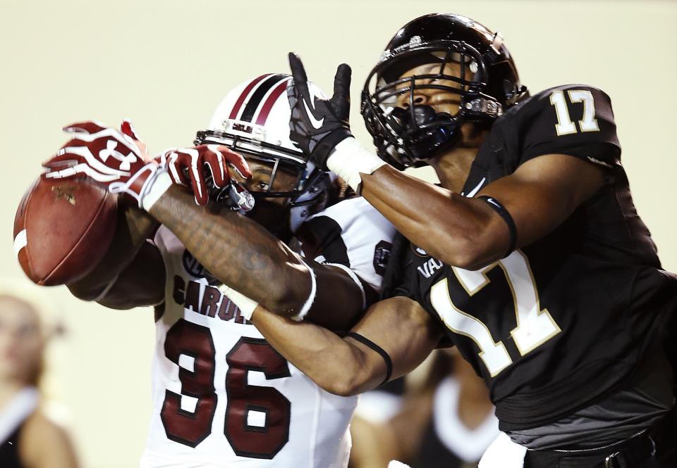 South Carolina's D. J. Swearinger (36) breaks up a pass intended for Vanderbilt's Jonathan Krause (17) in the second half of an NCAA college football game, Thursday, Aug. 30, 2012, in Nashville, Tenn. South Carolina won 17-13. (AP Photo/John Russell)