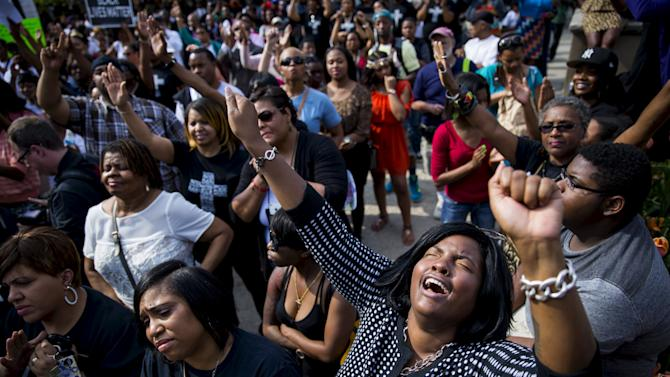 Demonstrators rally at city hall in Baltimore, Maryland