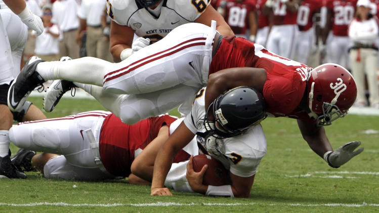 Alabama linebacker Dont'a Hightower (30) sacks Kent State quarterback Spencer Keith (3) for a loss in the first half of an NCAA college football game on Saturday, Sept. 3, 2011 in Tuscaloosa, Ala.  (AP Photo/Butch Dill)