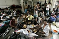 Bangladeshi migrant workers enjoy a Christmas charity meal at the Bangladeshi High Commission in Kuala Lumpur on 25 December 2007. Malaysia has resumed recruiting Bangladeshi migrant workers after a four-year pause, an official said Tuesday, in a move easing Dhaka's remittance worries after the jobs market in the Middle East dried up