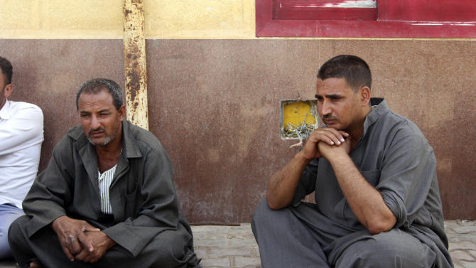 Egyptian relatives of border policeman Ahmed Abd el Hamid, who was kidnapped last Thursday in northern Sinai, stage a sit in at the Rafah, Sinai, border crossing between Egypt and the Gaza strip, Sunday, May 19, 2013. Rafah, the main crossing point into the Gaza Strip, was closed by policemen Friday, barring people from going in or out of the Palestinian territory. Scores of  protesting Egyptian police have also shut down the Awja commercial border crossing with Israel Sunday. (AP Photo/Roger Anis, El Shorouk Newspaper) EGYPT OUT